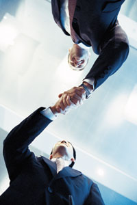 Client and Training Consultant shaking hands