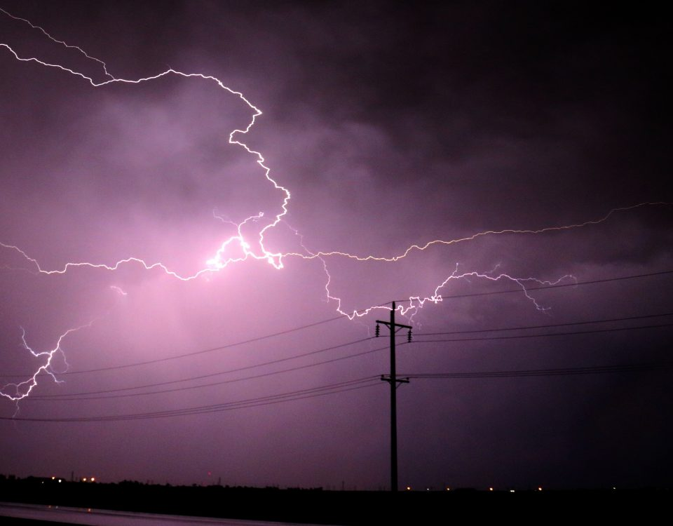 Lightning and Power Lines in a night storm