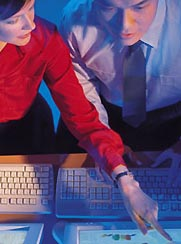 Instructor guiding trainee during Computer-Based Training