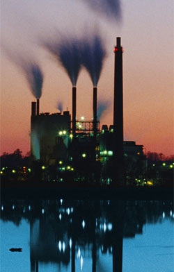 Coal Power Plant at Dusk with smokestacks