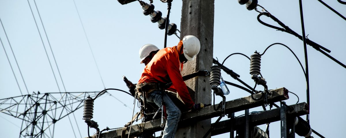Techs Repairing Power Poles