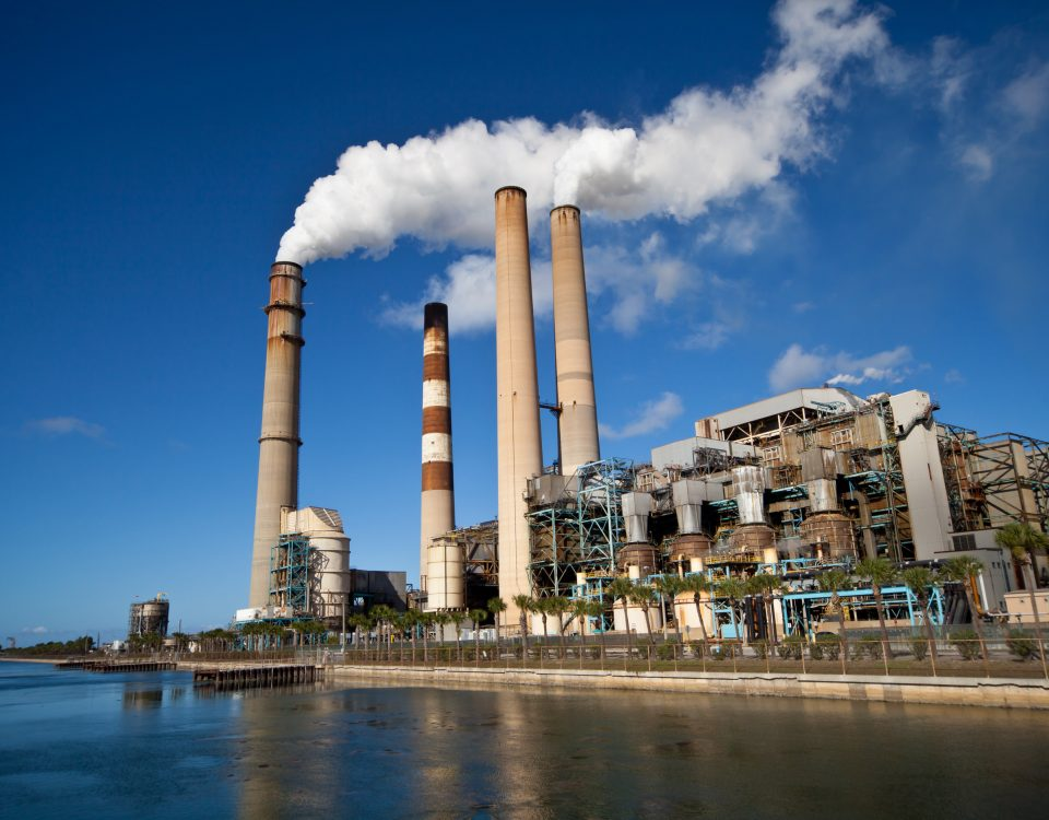Power generation plant with smokestack and blue sky