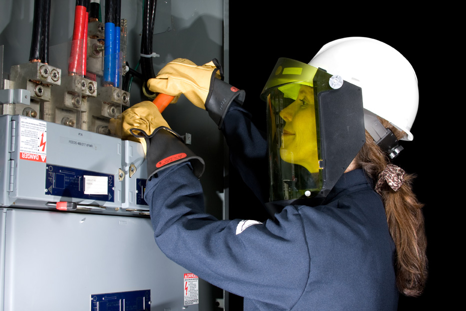 Operator performing equipment maintenance during Electrical Fundamentals Training
