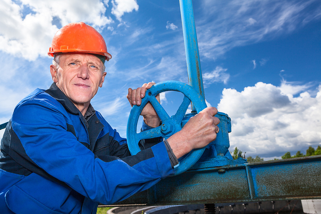 Experienced Power Plant Worker with Valve for Training