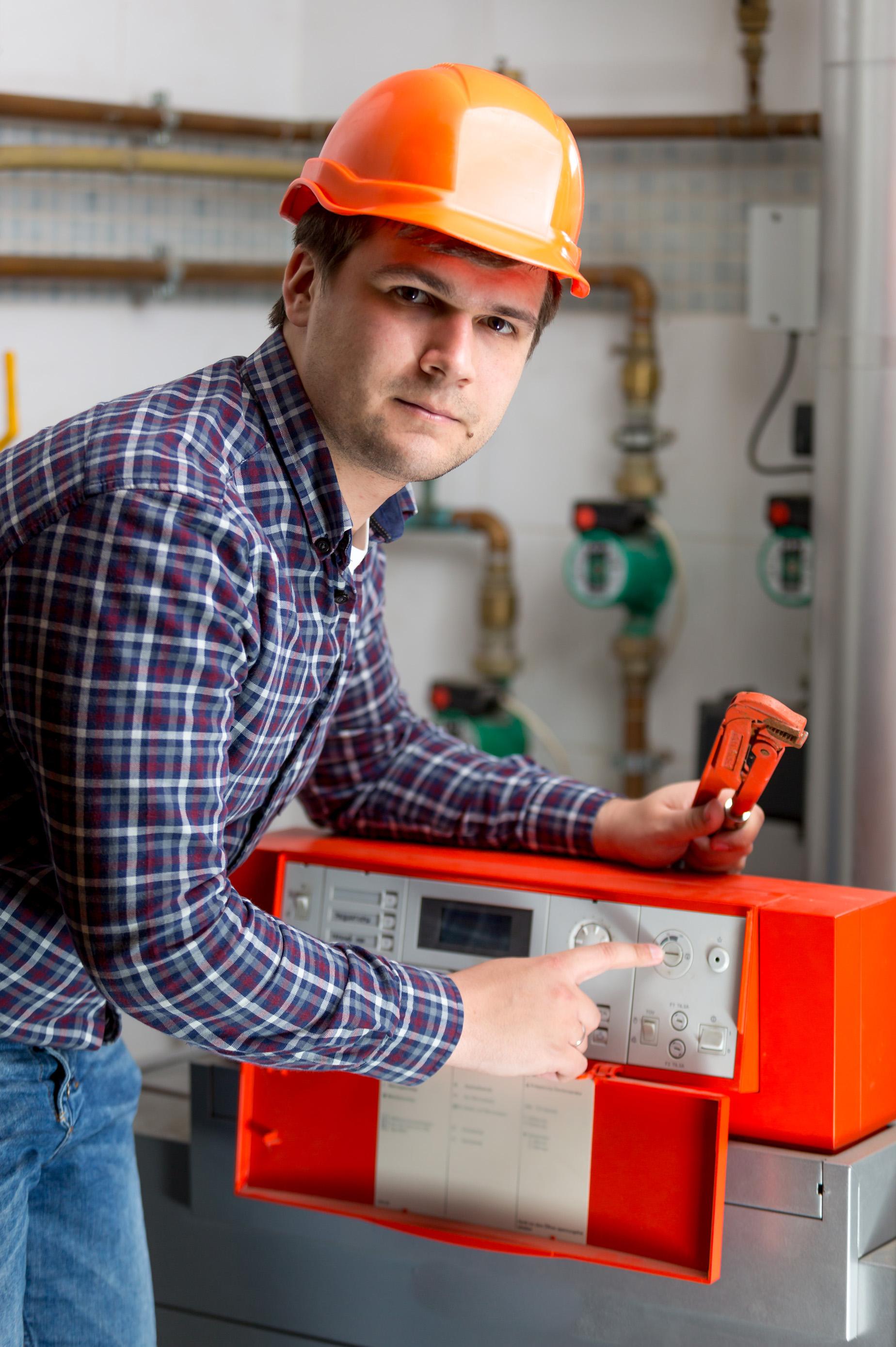 Engineer Adjusting Automated Control Dashboard