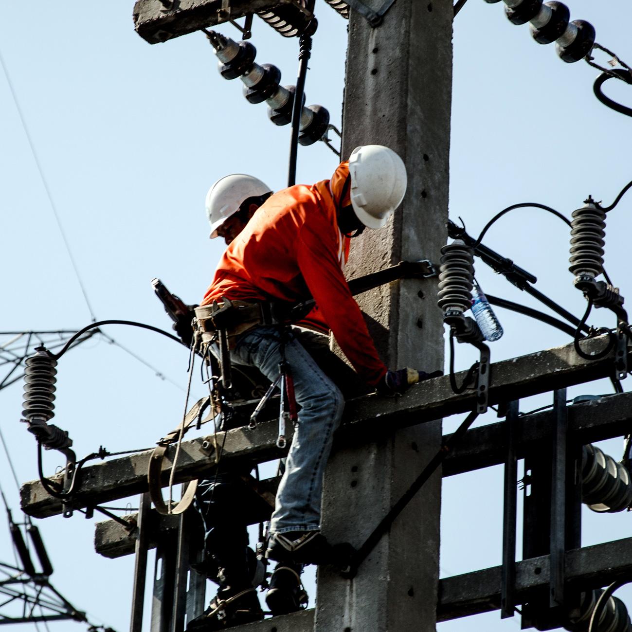 Techs Repairing Power Poles